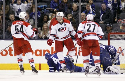 Jan 21, 2016; Toronto, Ontario, CAN; Carolina Hurricanes forward Jordan Staal (11) celebrates his overtime goal with defenseman Brett Pesce (54) and  defenseman Justin Faulk (27) as Toronto Maple Leafs defenceman Morgan Rielly (44) and goaltender James Reimer (34) kneel on the ice at the Air Canada Centre. Carolina defeated Toronto 1-0 in overtime. Mandatory Credit: John E. Sokolowski-USA TODAY Sports