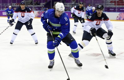 Feb 15, 2014; Sochi, RUSSIA; Slovenia forward Anze Kopitar (11) controls the puck while defended by Slovakia defenseman Zdeno Chara (33) in a men's preliminary round ice hockey game during the Sochi 2014 Olympic Winter Games at Bolshoy Ice Dome. Mandatory Credit: Scott Rovak-USA TODAY Sports
