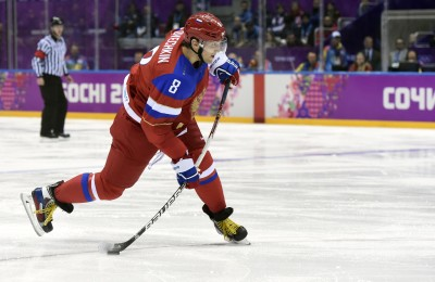 Feb 18, 2014; Sochi, RUSSIA; Russia forward Alex Ovechkin shoots the puck against Norway in a men's ice hockey playoffs qualifications game during the Sochi 2014 Olympic Winter Games at Bolshoy Ice Dome. Mandatory Credit: Scott Rovak-USA TODAY Sports