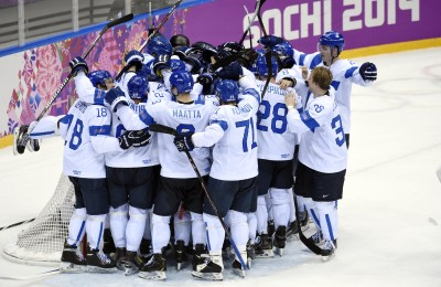 Feb 22, 2014; Sochi, RUSSIA; Finland goalie Tuukka Rask (40) is congratulated by teammates after defeating USA in the men's ice hockey bronze medal game during the Sochi 2014 Olympic Winter Games at Bolshoy Ice Dome. Mandatory Credit: Scott Rovak-USA TODAY Sports