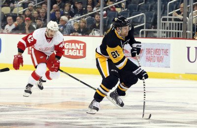 Oct 5, 2016; Pittsburgh, PA, USA;  Pittsburgh Penguins right wing Phil Kessel (81) skates with the puck ahead of Detroit Red Wings forward Martin Frk (42) during the first period at the PPG Paints Arena. Detroit won 5-2. Mandatory Credit: Charles LeClaire-USA TODAY Sports